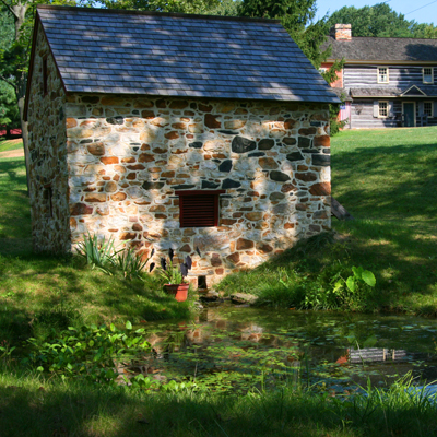 a fully restored spring house including a new roof and windows