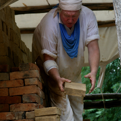 A man preparing bricks for a brick restoration project
