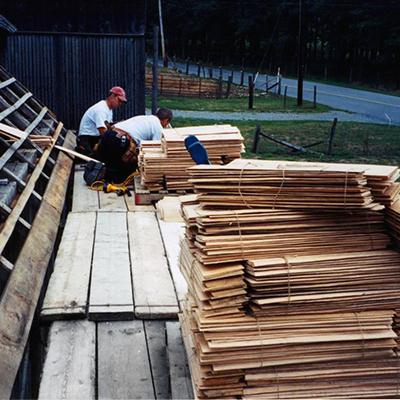 two men preparing custom made side lap shingles