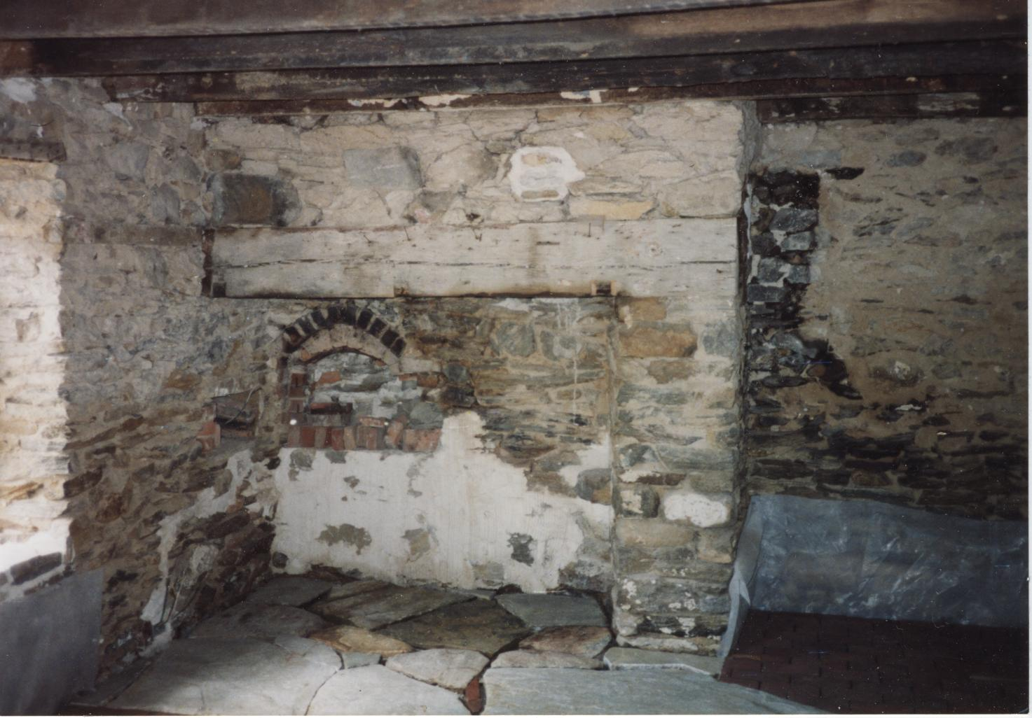 an old stone fireplace that is in bad shape  before Fireplaces Historic Fireplace Restoration