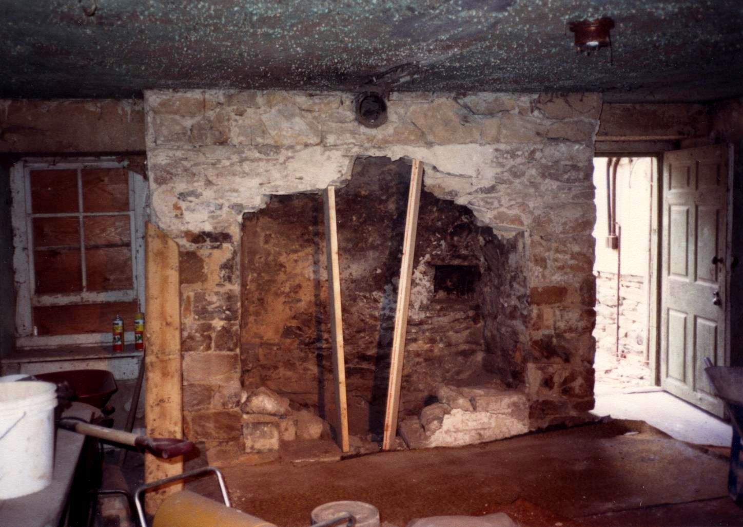 old stone fireplace. an old stone fireplace being opened up through removal of Fireplaces  Historic Fireplace Restoration