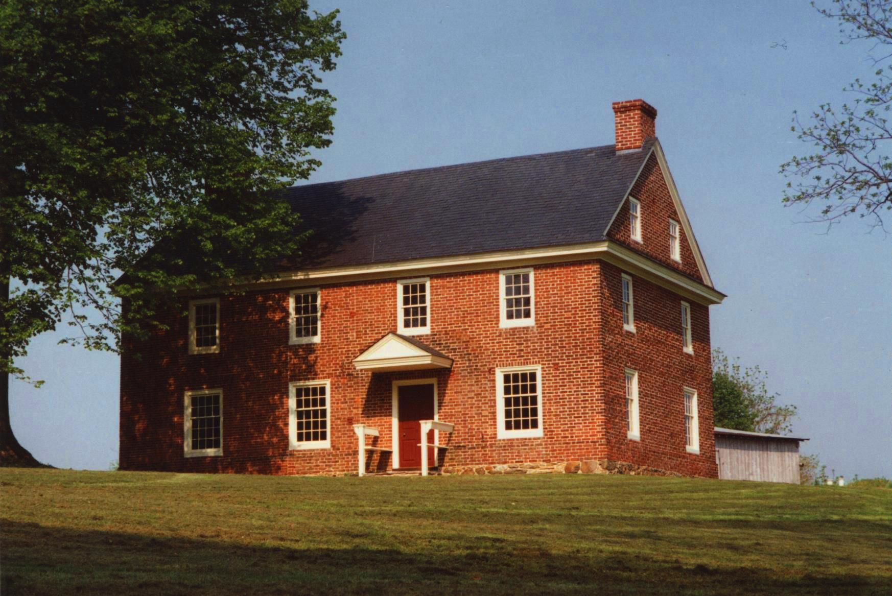 A fully restored brick home after historic preservation efforts.