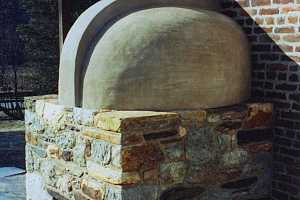 The outside view of a fully restored squirrel tail bake oven