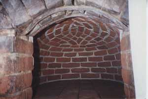 Restored brickwork inside a beehive bake oven