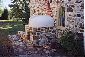 A fully restored squirrel tail bake oven