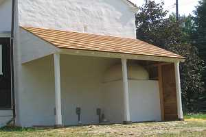 A awning over a beehive bake oven