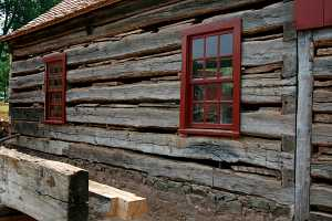 old log cabin with large gaps between logs