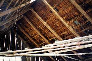 interior image of crumbling roof with holes