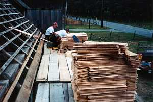 workers preparing wood for new shed roof