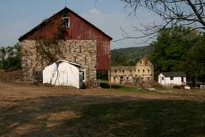 old farm buildings under vines