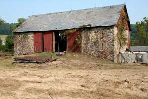 an old stone barn in need of repair