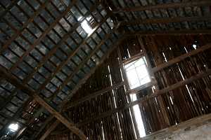 interior shot of damaged barn roof