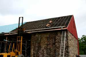 roofers removing existing barn roof