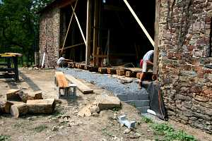 installation of new wood logs in an old barn