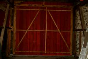 installed custom wooden barn door
