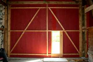 installation of window into barn door