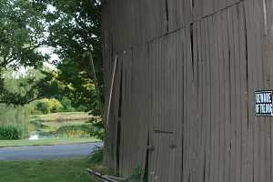 barn damage before restoration