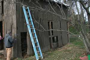 barn exterior being prepped for restoration