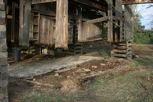 barn suspended on steel beams for foundation restoration