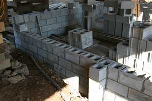 cinderblocks being stacked for a new barn foundation
