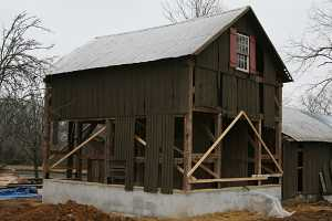 barn secured to new concrete foundation