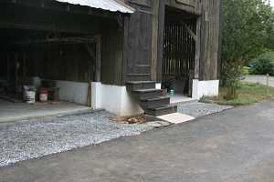 new custom stairs attached to barn entrance