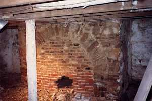 an old brick basement needing refinishing