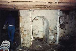 an old concrete basement with dirt floor