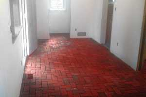 a red brick floor inside a building