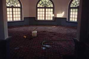 a brick floor inside a round room