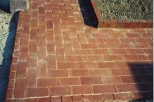 a closeup of a brick patios corner