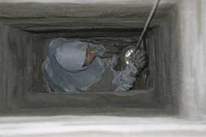A chimney flue in the process of being repaired