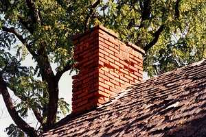 A brick chimney with some damage