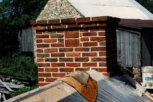 A repaired brick chimney