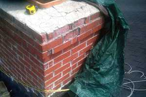 Closeup of brick chimney damage