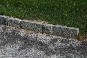 A close-up of cobblestone lining of a modern driveway
