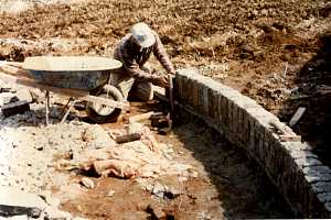 Man assembling a cobblestone driveway