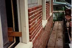reframing of windows on an old brick home