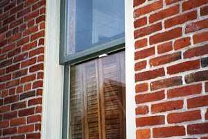 a window on a brick home