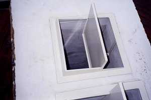 Close-up of small installed custom chimney damper