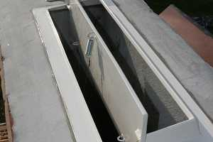 Close-up of large installed custom chimney damper
