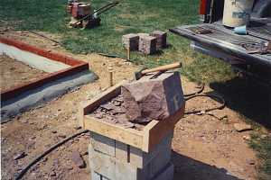 A large stone being prepped for cutting