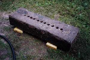 A large stone after being shaped and cut for use in a grate restoration