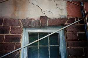 An old stone window frame in need of repair