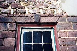 A restored stone window frame