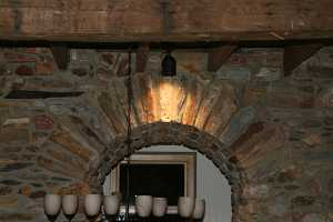 Stone arch doorway with accent lighting