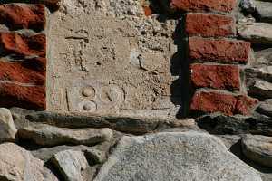 Faded date stone needing repairs