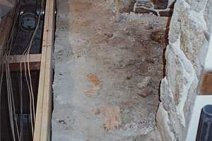 an old fireplace hearth concrete foundation