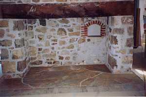 newly installed custom stone fireplace hearth