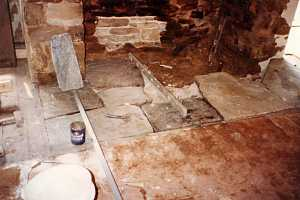 old fireplace hearth stone being removed and replaced